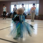 Aly watching tape dancers while on a costume parade at play group. She was mesmerized by them.